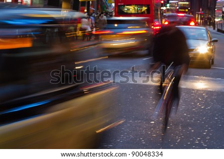 city traffic with motion blur at night in London