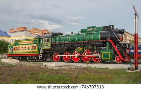 CITY ULAN UDE, REPUBLIC OF BURYATIA, RUSSIA - AUGUST 5,2017: Monument to railway workers at the railway station. Steam locomotive.