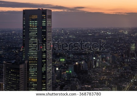 City view from the Big buildings and orange sky at evening in cloudy day