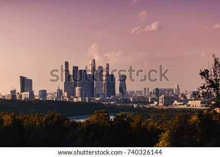 city view from the sparrow mountains to Moscow city in the evening in a pink sunset