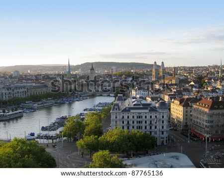 city view of Zurich at evening time. Zurich is the largest city in Switzerland, located in the canton of Zurich. - stock photo