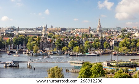 City view over Amsterdam, The Netherlands. The city is known as Venice of the North, its canal belt was finally added to the world heritage list in July 2010. - stock photo