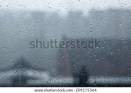 City view through a window on a rainy day - stock photo