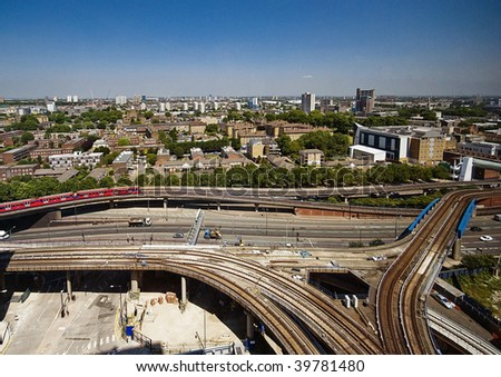 city view with busy junction and infrastructure - stock photo