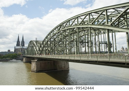 city views of cologne cathedral and railway bridge over the Rhine river, Germany,europe - stock photo