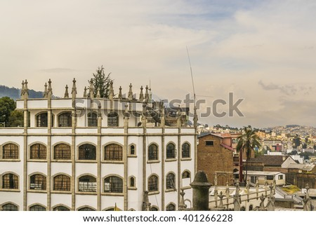 Cityscape aerial view of historic center of Quito city from the top of San Juan Basilica church. - stock photo
