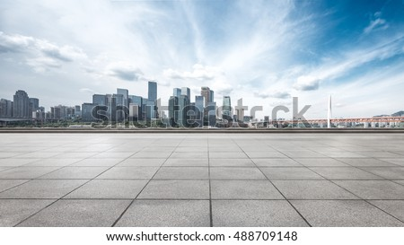 cityscape and skyline of chongqing from empty brick floor