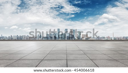 cityscape and skyline of chongqing in cloud sky on view from empty floor - stock photo