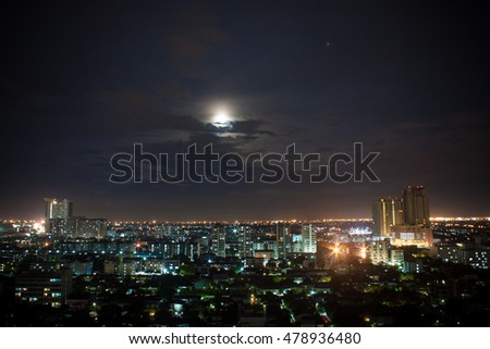 Cityscape and the moon.