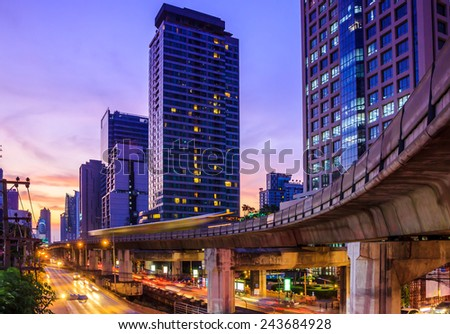 cityscape at dusk with sky train - stock photo