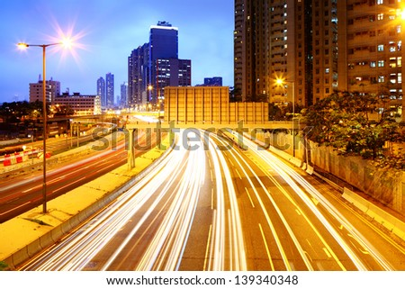 Cityscape at night with light trail