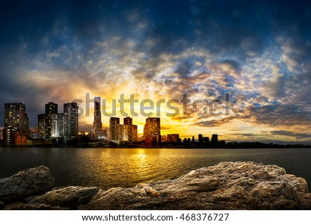 Cityscape at the riverside and blue sky in sunset time