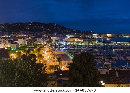 Cityscape by night from Cannes, France - stock photo