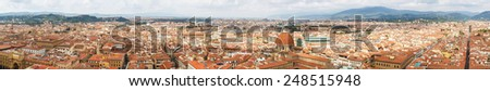 Cityscape from height, roofs of red tiles and narrow streets of Florence, Italy - stock photo