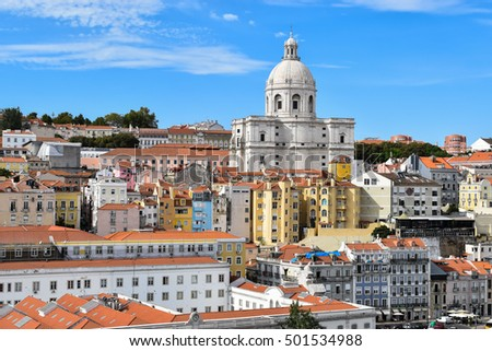 Cityscape from port of Lisbon with beautiful view over historical buildings and famous Dome of Santa Engracia with blue sky background.