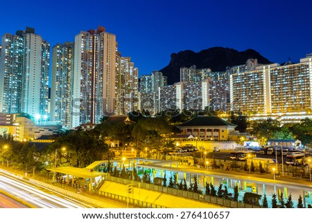 Cityscape in Hong Kong with lion rock mountain