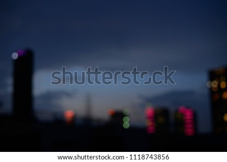 Cityscape In The Night Time Of Capital City With Many Building And Lighting  For Background And