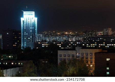 cityscape night lights of the city to the horizon with a high-rise building