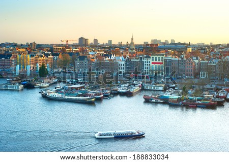 Cityscape of Amsterdam at colorful sunset. Aerial view  - stock photo