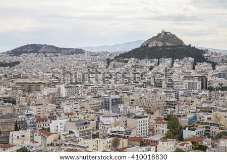 Cityscape of Athens.  Lycabettus Hill in the background. - stock photo