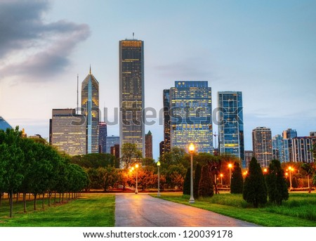 Cityscape of Chicago as seen from the Central Park in the evening - stock photo