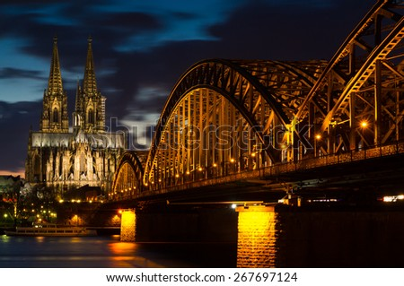 Cityscape of Cologne at twilight with the cathedral and Hoherzollern bridge - stock photo