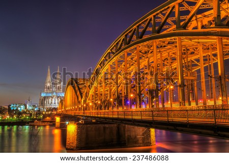 Cityscape of Cologne from the Rhine river at night time - stock photo