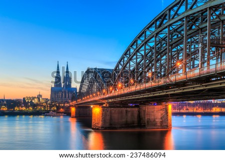 Cityscape of Cologne from the Rhine river with blue sky at sunset - stock photo