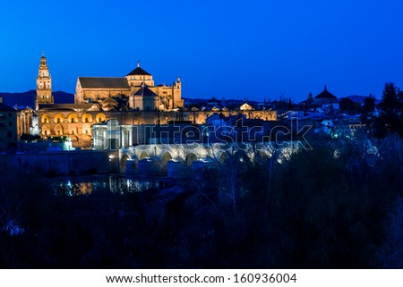 Cityscape of Cordoba at sunset with roman bridge and Mezquita, Andalusia, Spain - stock photo