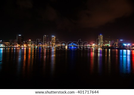 Cityscape of Da Nang city in Vietnam, with night illumination and modern buildings.