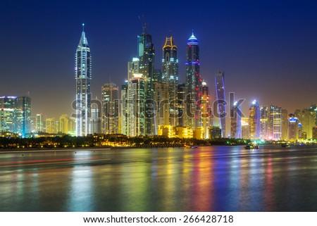 Cityscape of Dubai at night, United Arab Emirates - stock photo