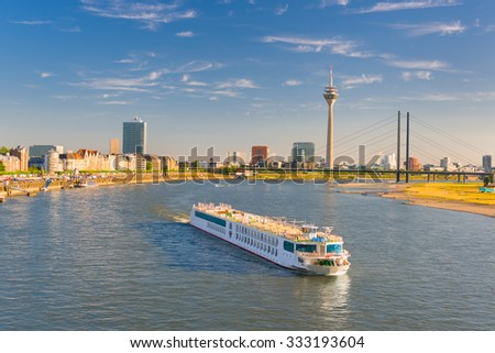 Cityscape of Dusseldorf over the Rhine river in a sunny summer day