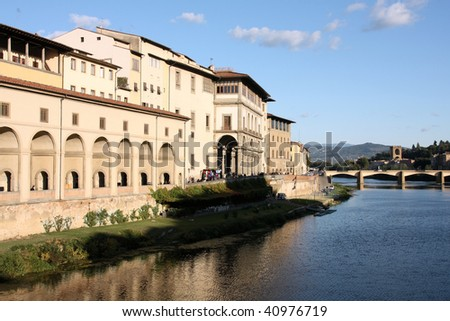 Cityscape of Florence, Italy with river Arno reflection. Uffizi Gallery.