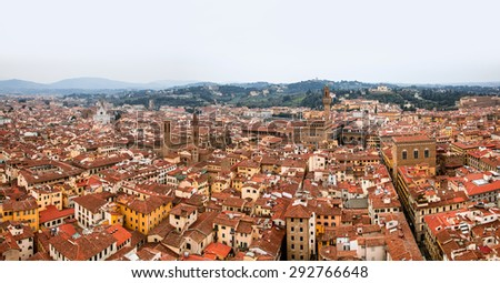 Cityscape of Florence on sunny day with multiple tiled roofs and historical monuments - stock photo