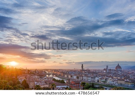 Cityscape of Florence with famous landmarks -the Cathedral Santa Maria del Fiore, Ponte Vecchio and Palazzo Vecchio. View from piazzale Michelangelo at sunset, Italy.