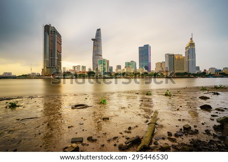 Cityscape of Ho Chi Minh city at beautiful sunset, viewed over Saigon river. Hochiminh city is the largest city in Vietnam with population around 10 million people - stock photo