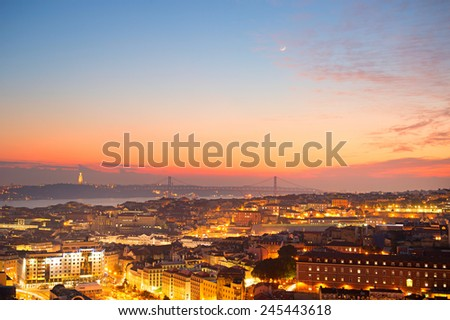 Cityscape of Lisbon at dusk with new moon in the sky. Portugal - stock photo