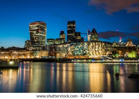 Cityscape of London business area at night, United Kingdom  - stock photo