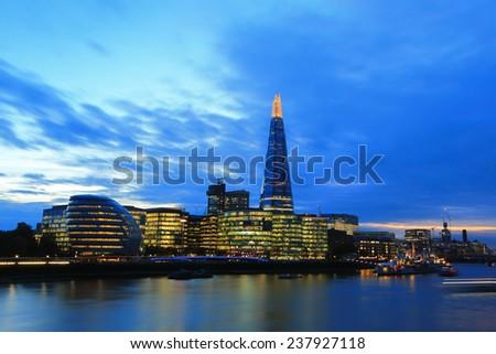 Cityscape of London business building skyline at night, United Kingdom, uk - stock photo
