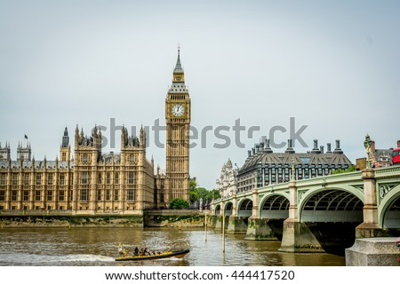 Cityscape of London with the famous Big Ben by the Westminster bridge, with the sightseeing boat tour passing by. Big Ben is the nickname for the Great Bell of the clock tower, aka Elizabeth Tower. - stock photo