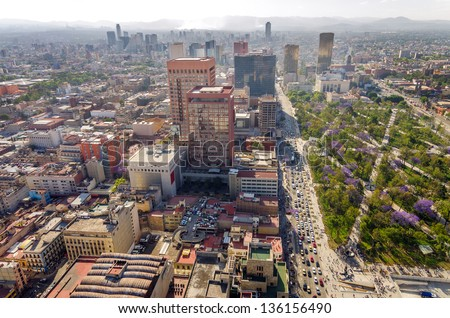 Cityscape of Mexico City with a large park and skyscrapers in the background - stock photo