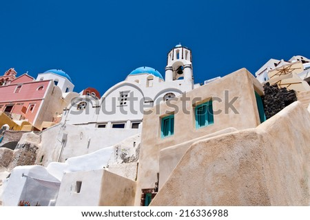 Cityscape of Oia town with cave houses on the island of Thera (Santorini), Greece. - stock photo