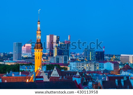 Cityscape of old Tallinn, old and modern buildings at twilight
