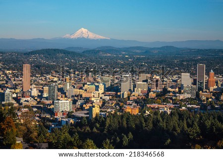 cityscape of Portland, Oregon and Mount Hood towering in distance, autumn afternoon