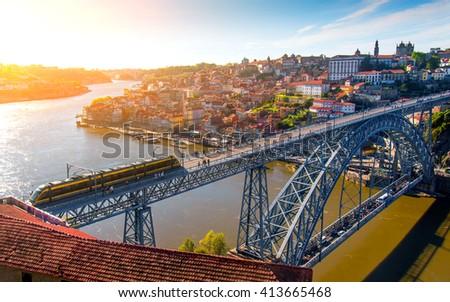 Cityscape of Porto downtown touristic Ribeira and D Luis Bridge - stock photo