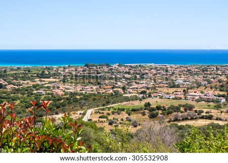 cityscape of San teodoro in the oriental coast of Sardinia, with the mediterranean sea in the background , Italy - stock photo