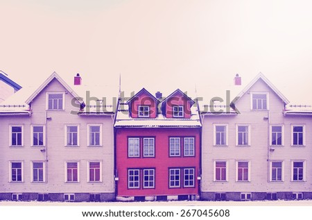 Cityscape of small town street with wooden houses in Norway with instagram effect retro vintage filter - stock photo