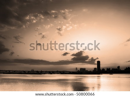 Cityscape of sunset near the river with dramatic sky in Taipei.