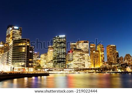 cityscape of sydney at nightfall - stock photo
