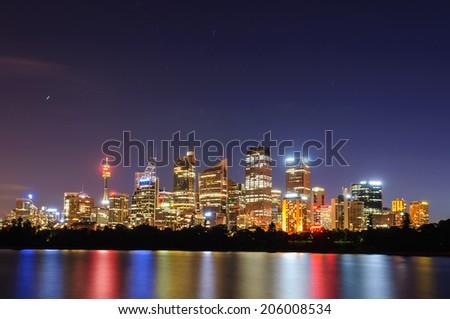 Cityscape of Sydney at sunset illuminated skyscrapers australia landmark - stock photo